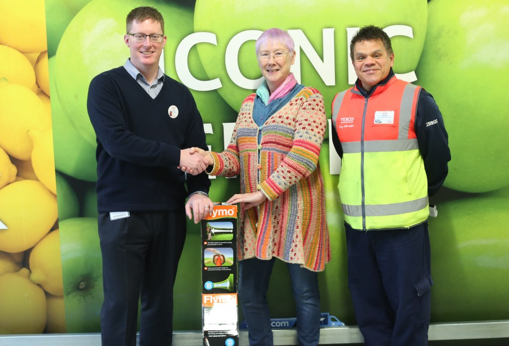 Receiving hedge trimmer donated by Tesco's